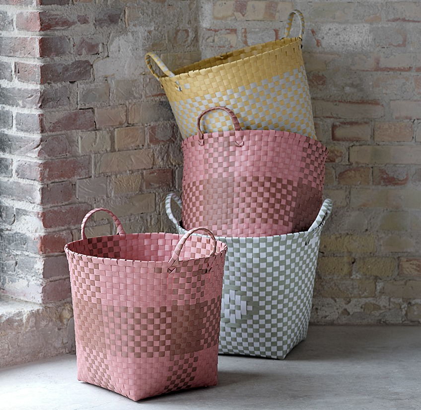 Four baskets in different colours stacked