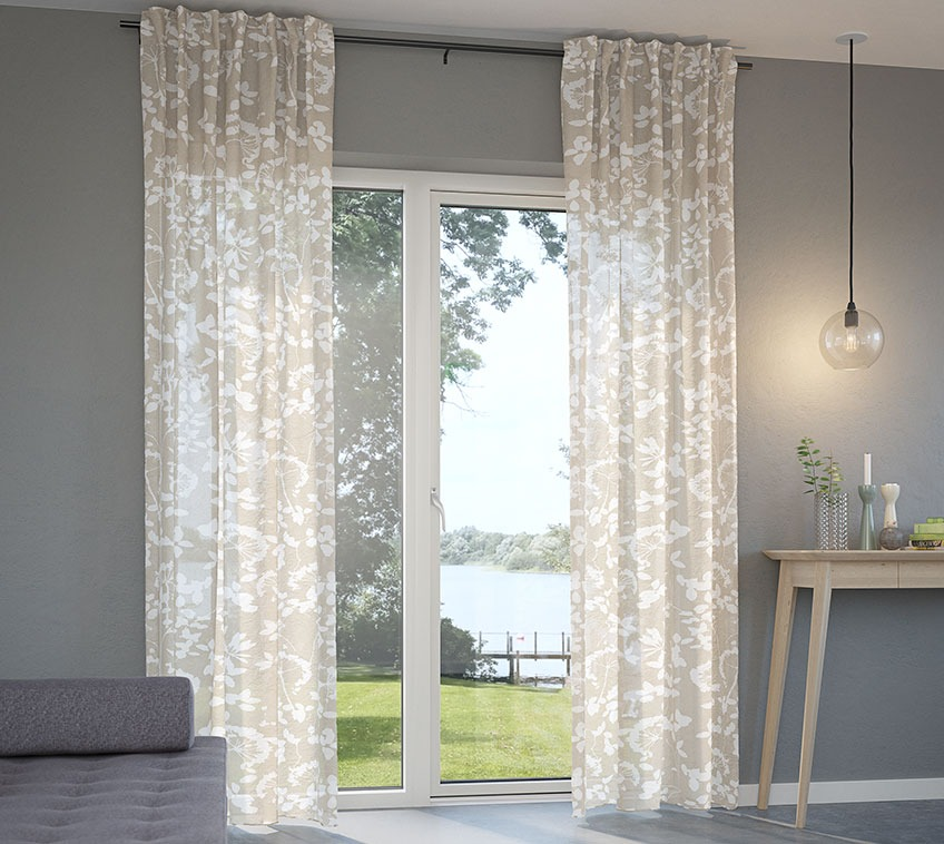Lightweight curtains in front of a patio door