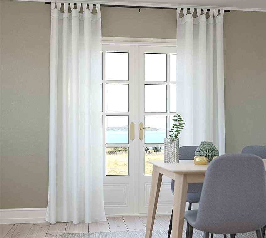 Dining room with lightweight curtains in front of the window