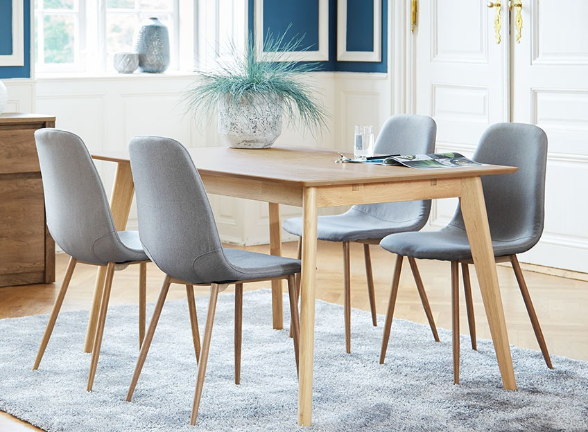 Oak dining table and grey dining chairs in a classy dining room